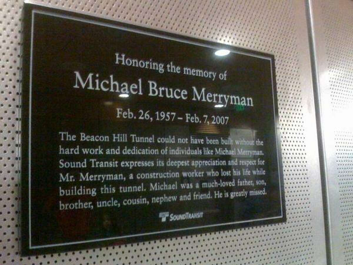A plaque pays tribute to construction worker Michael Bruce Merryman, who died during the construction of the Beacon Hill Tunnel.