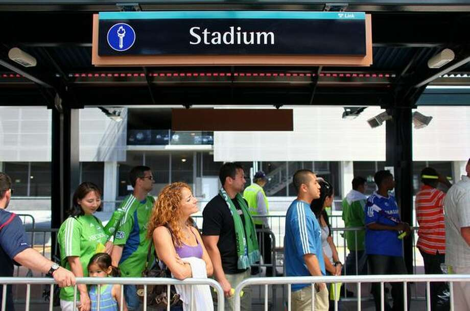Passengers wait for a Link light rail train at the Stadium Station in Seattle after the Seattle Sounders soccer game on Saturday July 18, 2009. Sound Transit's new Link light rail began service between Westlake Center and Tukwila and seemed to handle the crowds without major problems. Photo: Joshua Trujillo, Seattlepi.com