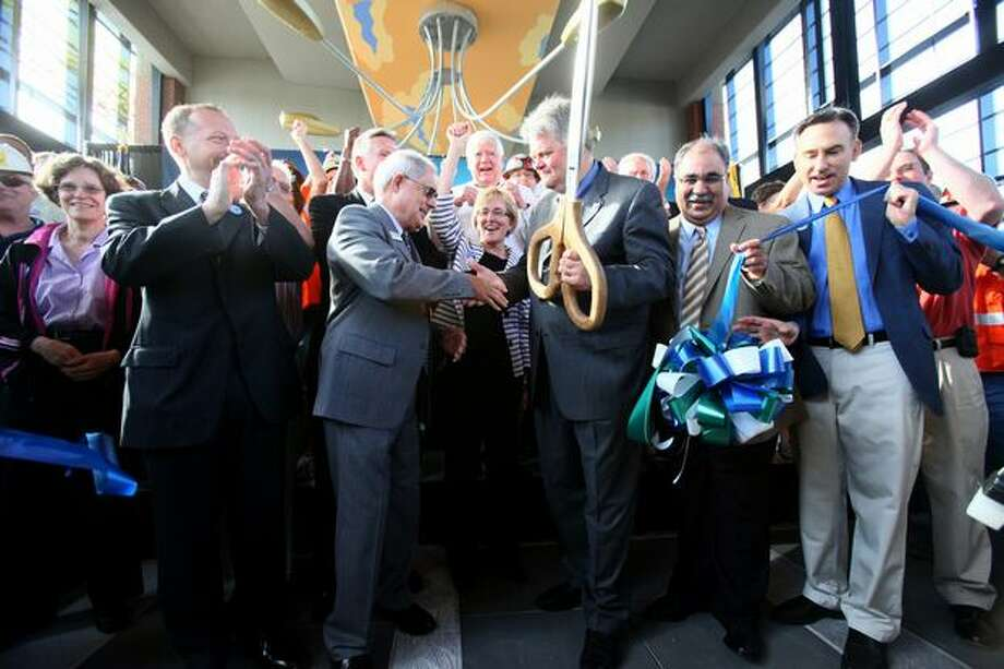 Officials, including Seattle Mayor Greg Nickels, center right, Tukwila Mayor Mayor Jim Haggerton, center left, and Sound Transit Executive Director Joni Earl, center, cut a ribbon at the Mount Baker Station to mark the beginning of Link light rail on Saturday July 18, 2009. Sound Transit's new Link light rail began service between Westlake Center and Tukwila. Photo: Joshua Trujillo, Seattlepi.com
