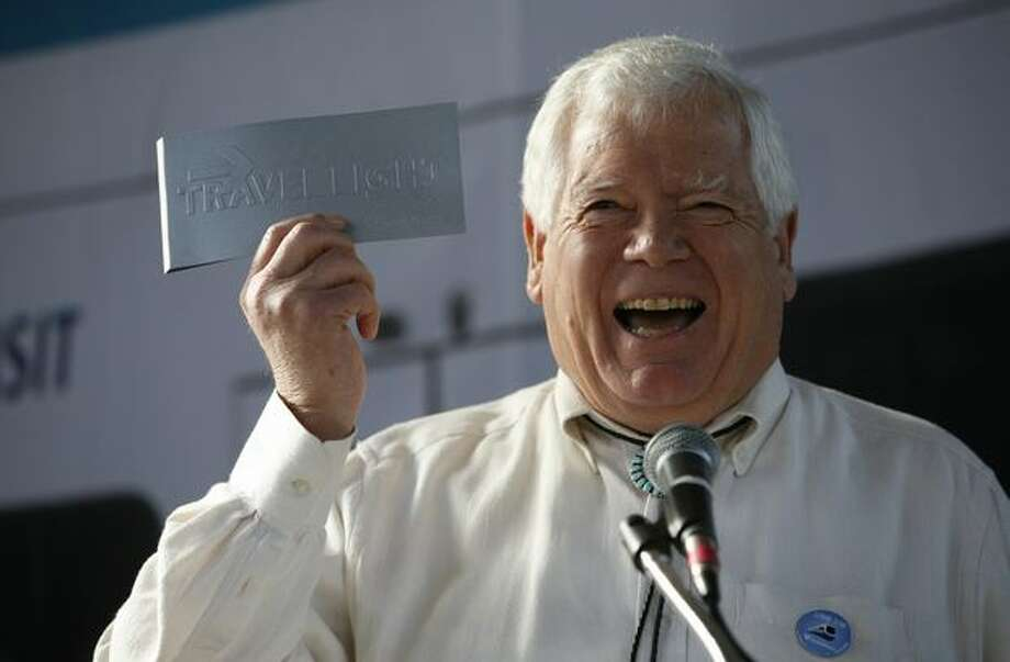 U.S. Representative Jim McDermott shows his pass to ride Sound Transit's new Link light rail at the Mount Baker Station with officials from Seattle during the kickoff of service on Saturday July 18, 2009. Photo: Joshua Trujillo, Seattlepi.com
