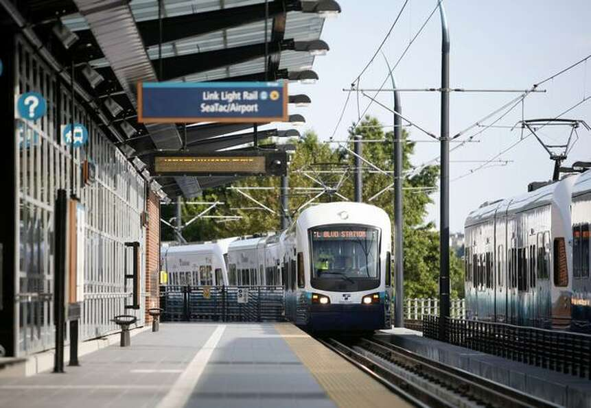 One of the first scheduled, passenger-carrying light rail trains arrives at the Mount Baker Station