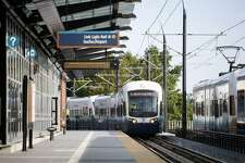 One of the first scheduled, passenger-carrying light rail trains arrives at the Mount Baker Station with officials from Seattle during the kickoff of service on Saturday July 18, 2009. Sound Transit's new Link light rail began service between Westlake Center and Tukwila.