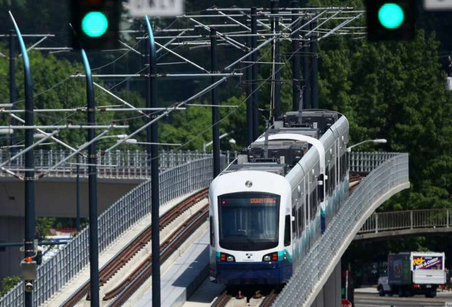 A Link light rail train arrives at the Mount Baker Station during the kickoff of service on Saturday July 18, 2009. Sound Transit's new Link light rail began service between Westlake Center and Tukwila. Photo: Joshua Trujillo, Seattlepi.com