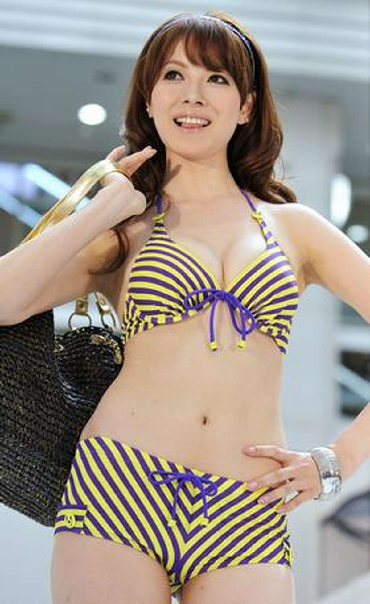 Models display swimsuits from a collection by Japanese apparel giant Sanai, at a Tokyo shopping mall to celebrate 'Marine Day', a Japanese national holiday.
