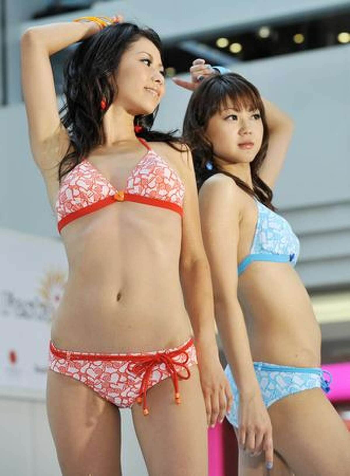 Models display swimsuits from a collection by Japanese apparel giant Sanai at a Tokyo shopping mall to celebrate 'Marine Day', a Japanese national holiday.