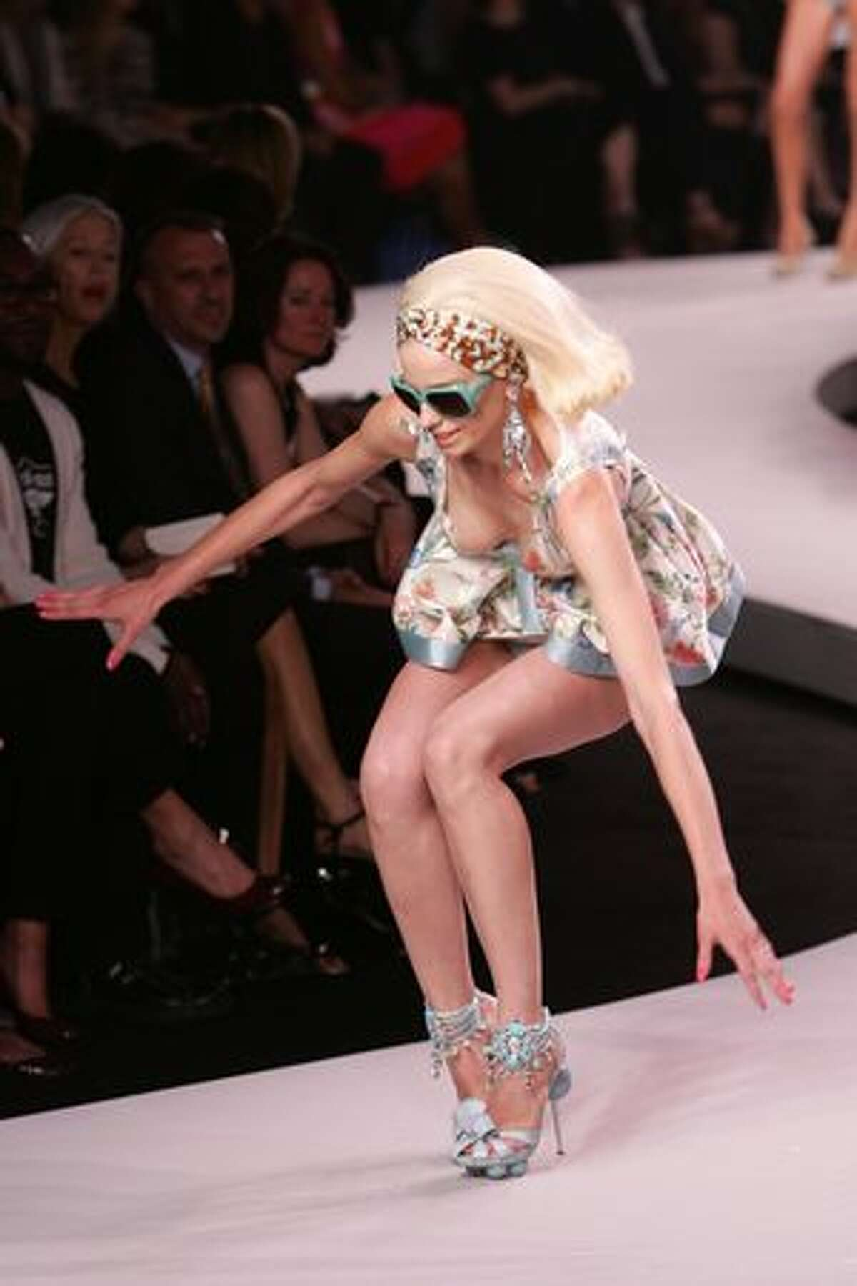 A model stumbles while walking the runway at the Dior 2008 Cruise Collection fashion show on May 14, 2007 in New York City.