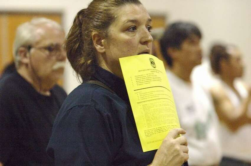Barbara Apodaca, who has lived in the South Park area almost eight years, listens during a public meeting at the South Park Community Center to discuss the stabbing of an area resident.