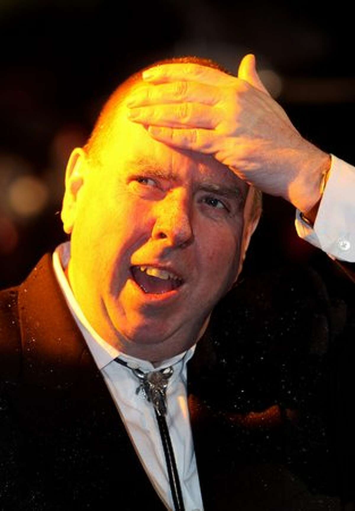A rain soaked actor Timothy Spall attends the Royal World Premiere of