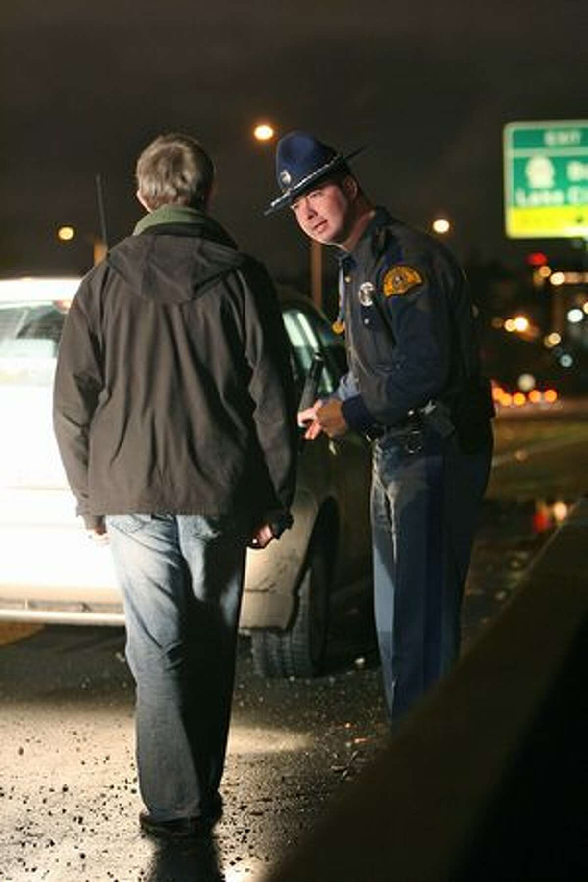 Washington State Patrol Trooper Joe Gannon administers a field sobriety test to a suspected drunken driver he pulled over on Interstate 5 in Dec., 2007.