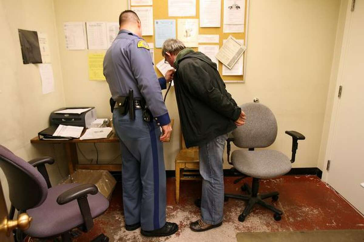 Washington State Patrol Trooper Joe Gannon administers breath-alcohol test to a suspected drunken driver he arrested on Interstate 5 in Dec. 2007. The driver blew a .156, nearly double the legal limit.