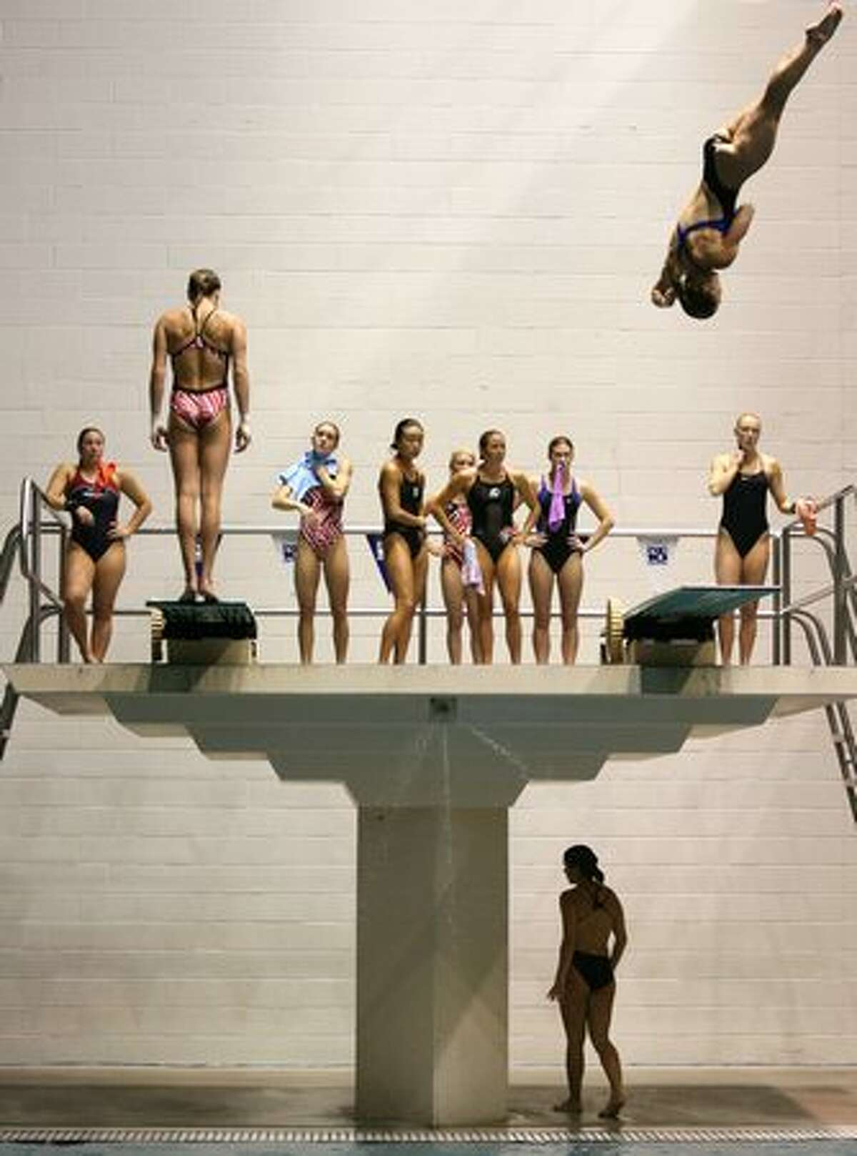 The PAC-10's top female divers prepare for the women's three-meter preliminary diving competition. The PAC-10 diving championships are being held this weekend at the Weyerhaeuser-King County Aquatic Center in Federal Way. Competition continues through Saturday. (David Ryder/Seattlepi.com)