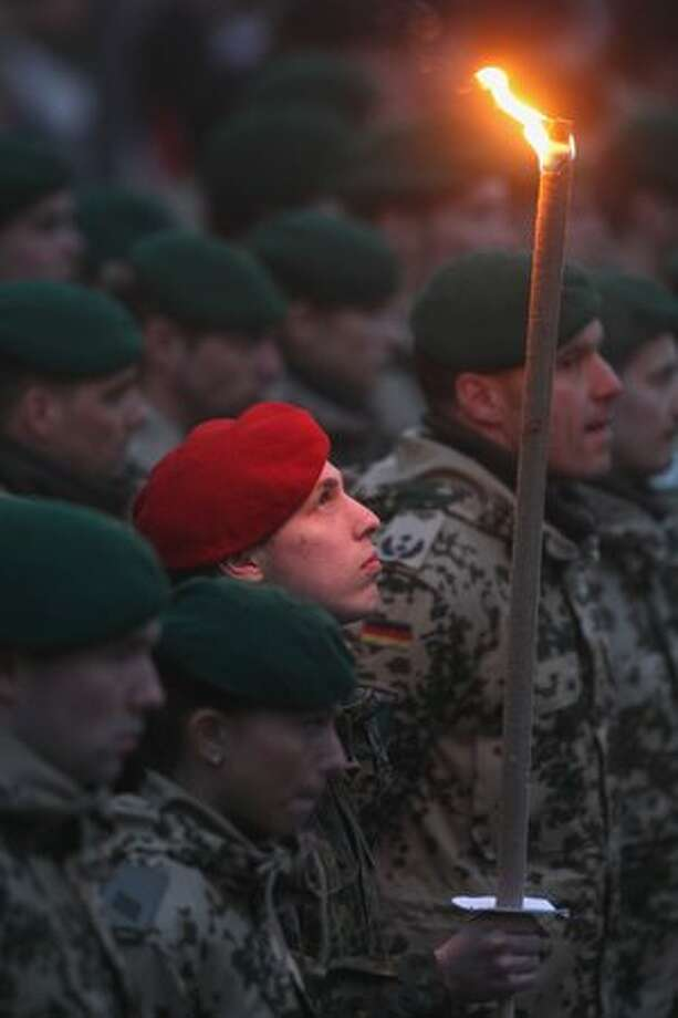 Soldiers of Tank Grenadier Brigade 37 (Panzergrenadierbrigade 37) of the German Bundeswehr stand at attention at a ceremony marking their deployment to Afghanistan on March 6 in Frankenberg, Germany. Photo: Getty Images