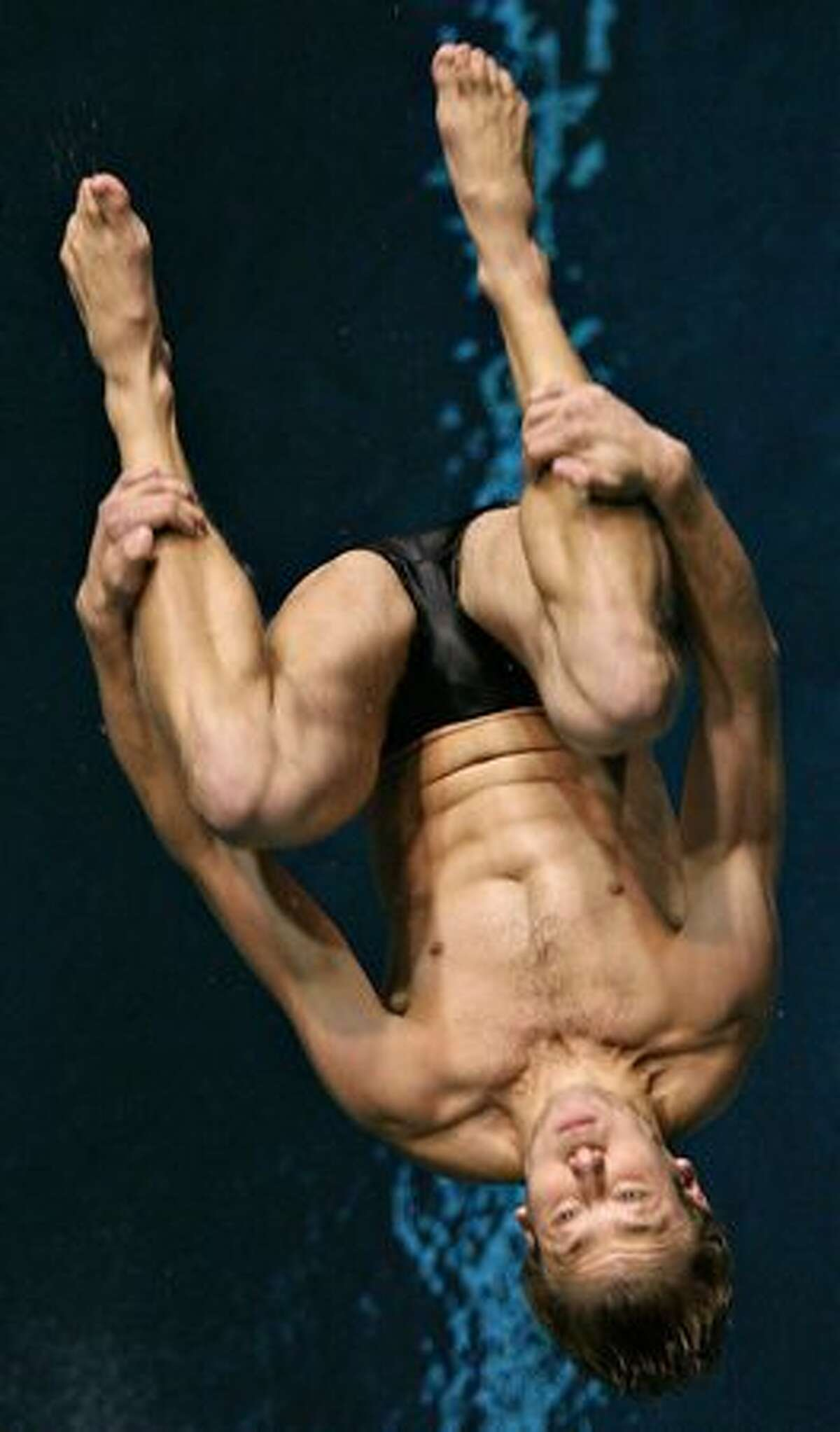 Steven Starks of USC competes in the finals of the men's one-meter diving competition. The PAC-10 diving championships are being held this weekend at the Weyerhaeuser-King County Aquatic Center in Federal Way. Competition continues through Saturday. (David Ryder/Seattlepi.com)