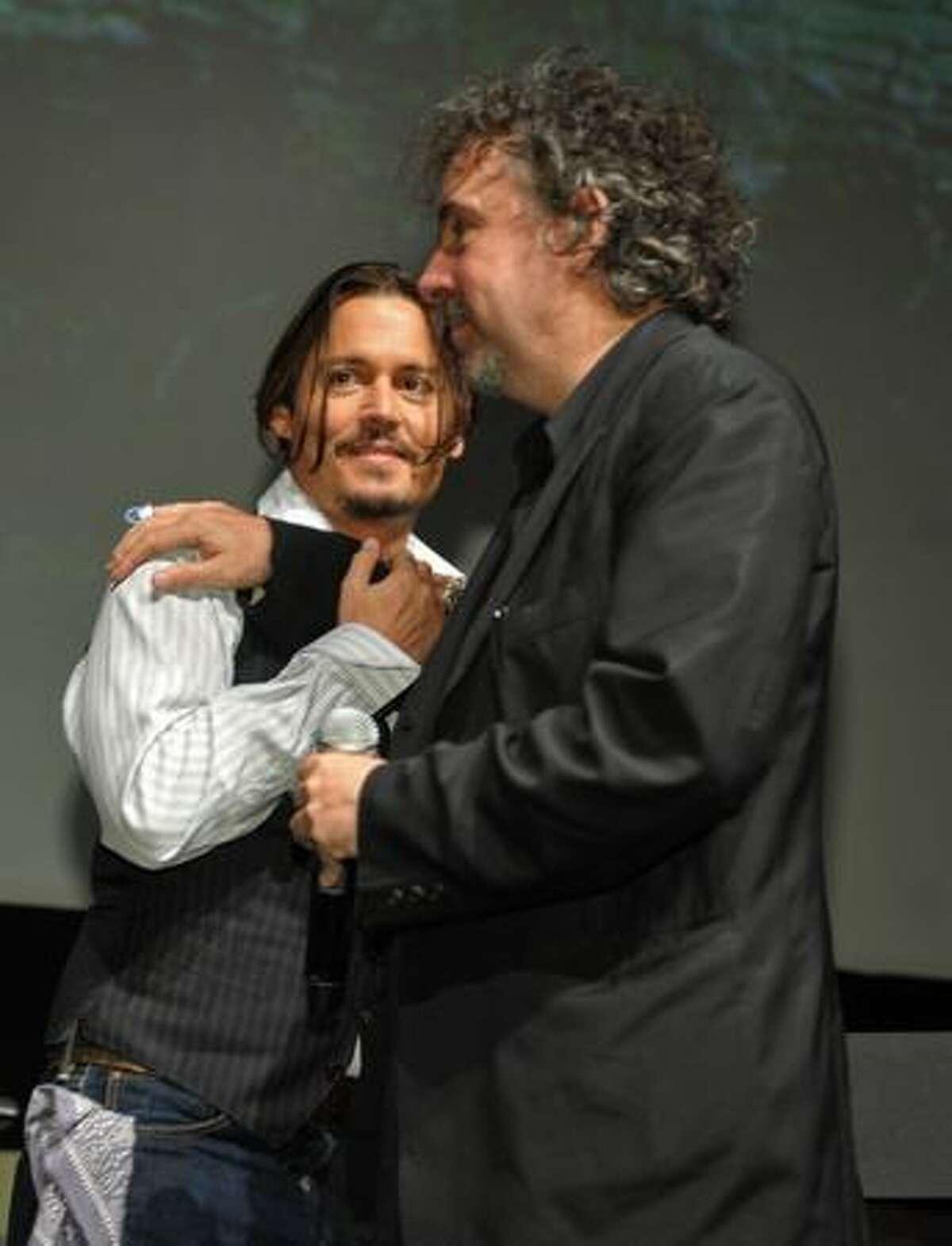 (L-R) Actor Johnny Depp and director Tim Burton speak at