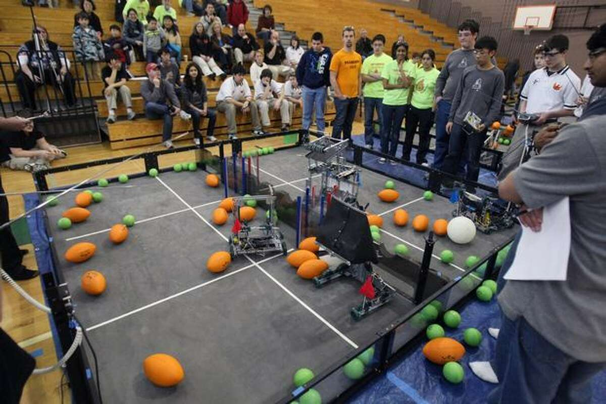 Teams made up of high school and junior high school students from .Washington, Oregon, California and British Columbia compete during the Washington State VEX Robotics Competition at Redmond High School on Saturday Feb. 27, 2010. All robots were designed and built by the students.