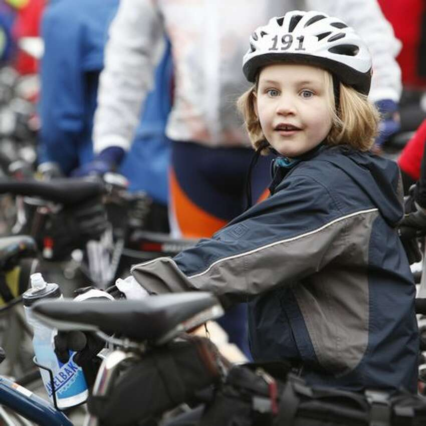 Bicyclists prepare for the annual Chilly Hilly bike ride on Bainbridge Island.