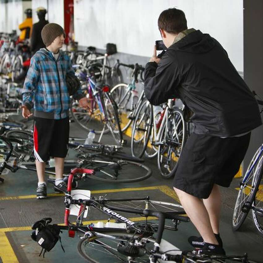 Bikers take a photo while waiting to arrive on Bainbridge.