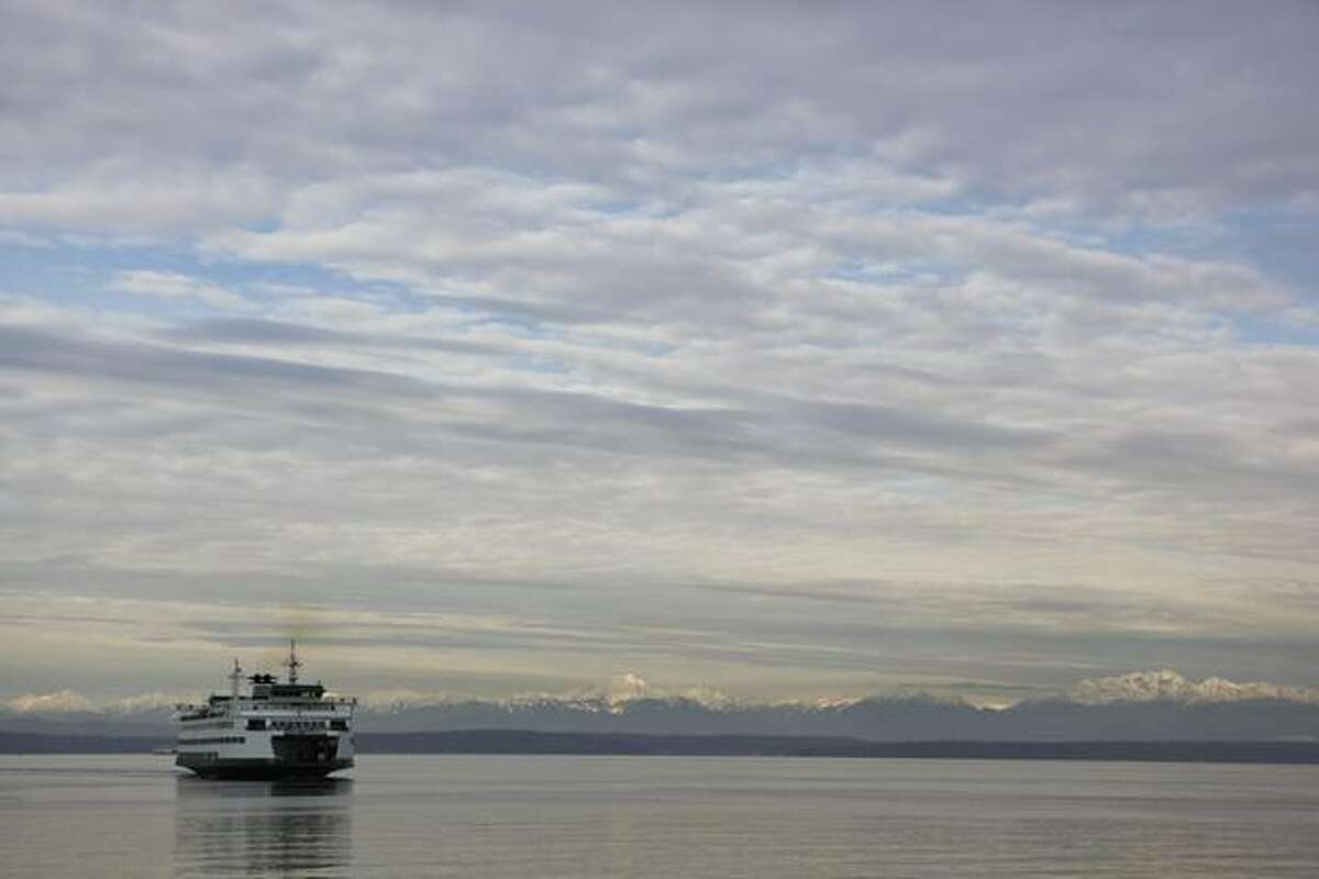The Seattle to Bainbridge ferry, the Tacoma, approaches Seattle.