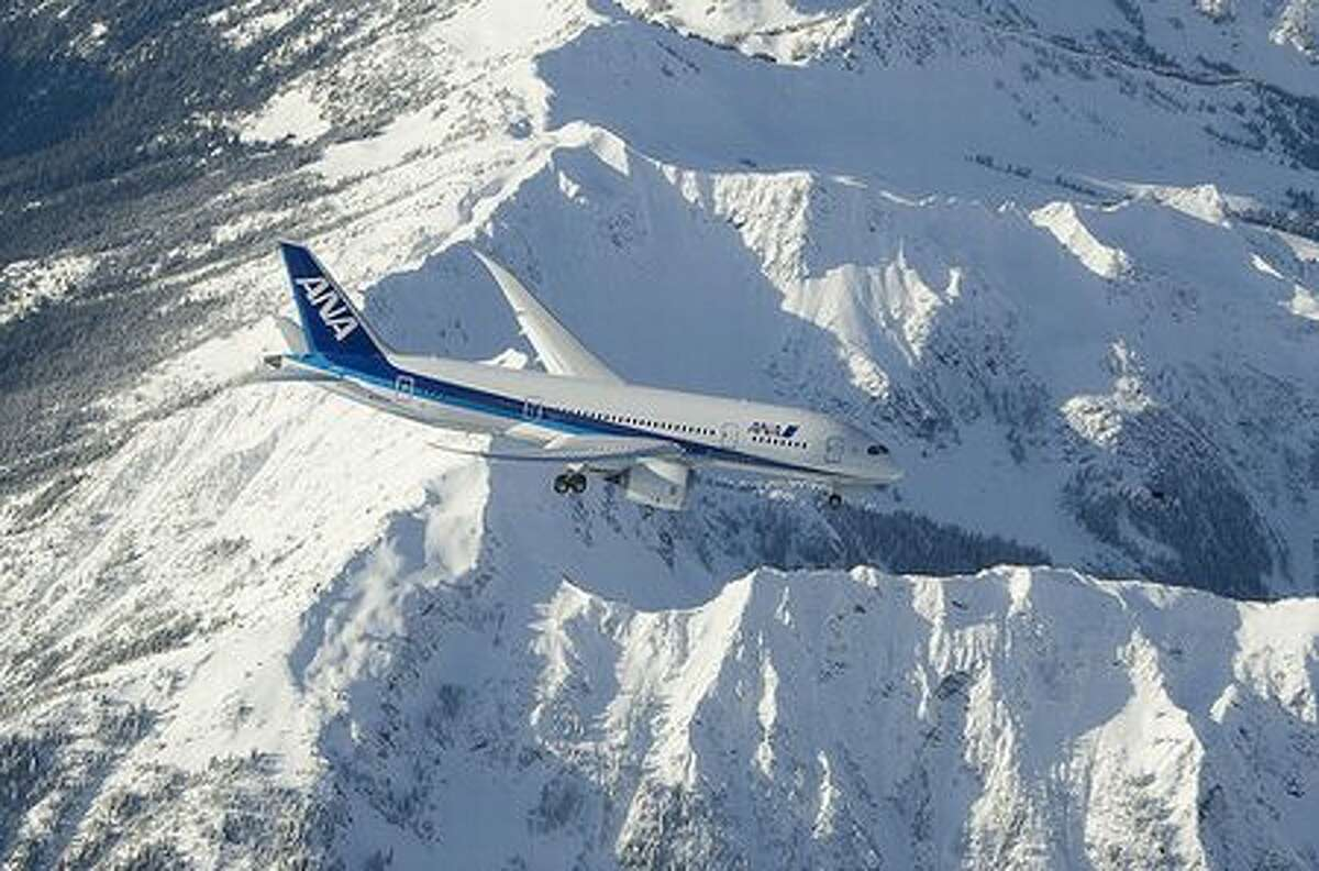 Boeing's second 787 Dreamliner over the Olympic Mountains during its first test flight, on Dec 22, 2009. (via Future of Flight)