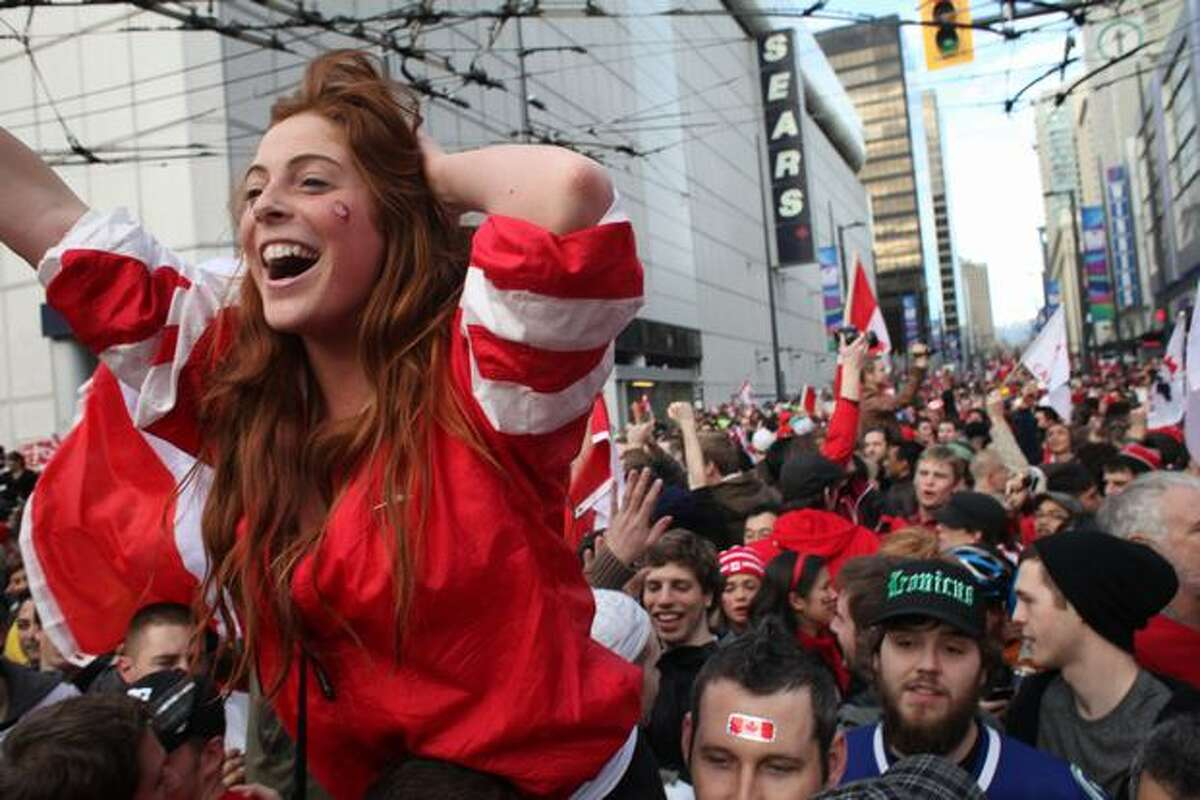 Canadians flood the streets in Vancouver, B.C., on Sunday. The Olympics finished with a bang when the city erupted in celebration after the Canadian men's hockey team triumphed in overtime over the U.S. to win the gold medal. The entire final weekend was a wild one in Vancouver.