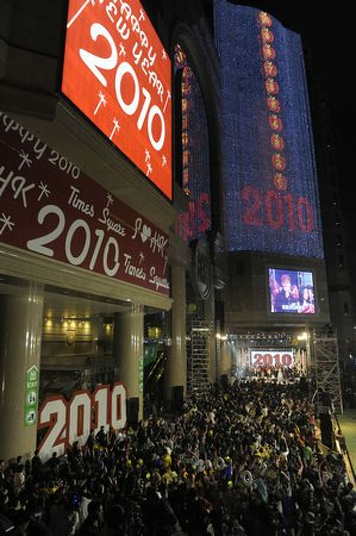 People celebrate the incoming new year outside a shopping mall in Hong Kong.