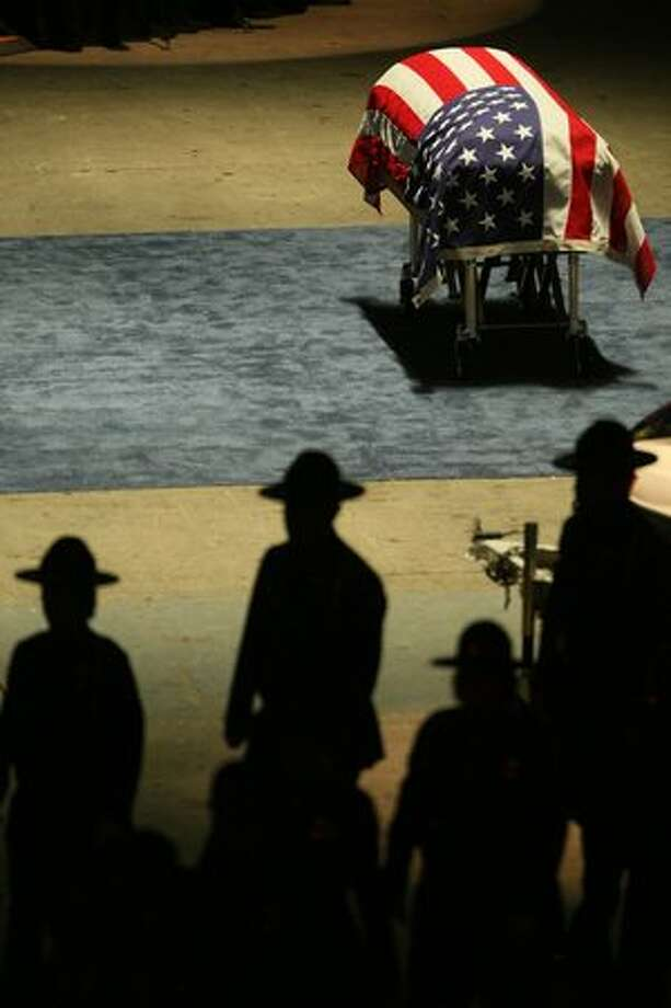 The casket sits near the stage during the memorial service for Pierce County Sheriff's Deputy Kent Mundell, Jr. at the Tacoma Dome Jan. 5, 2010. Photo: Thom Weinstein, Special To Seattlepi.com