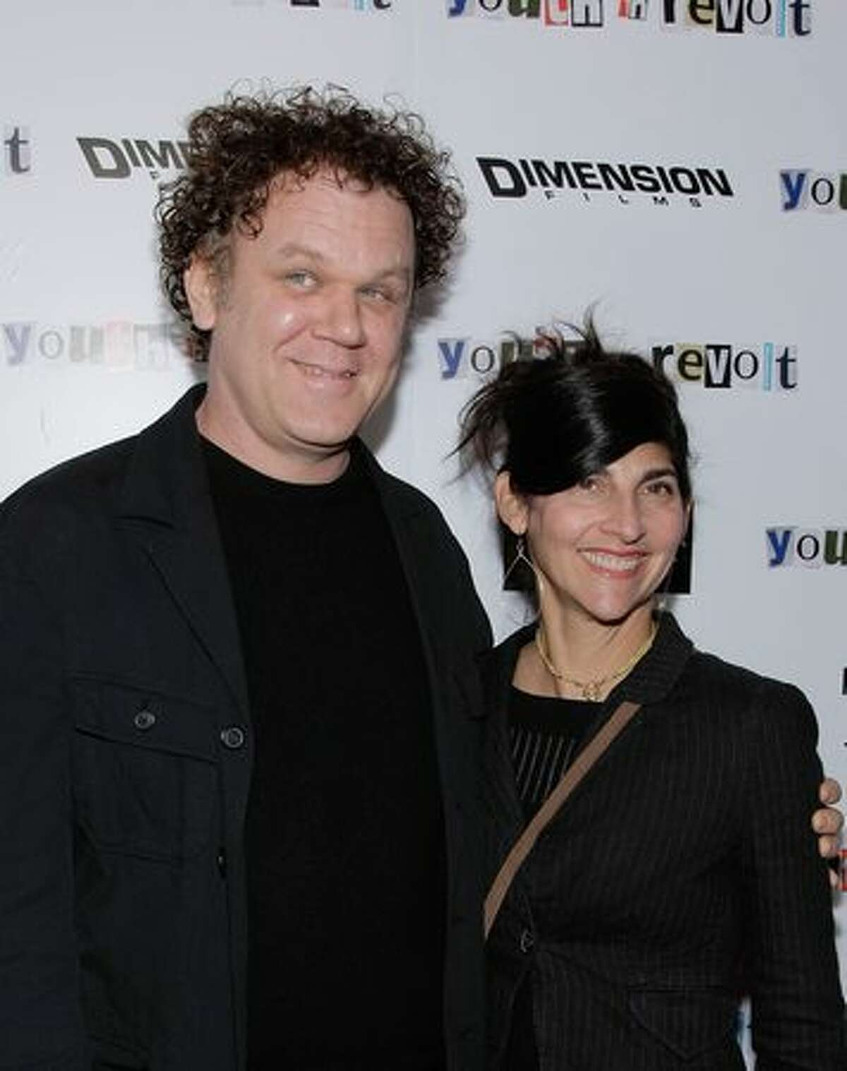 John C. Reilly (L) and his wife Alison Dickey (R) attend the premiere of