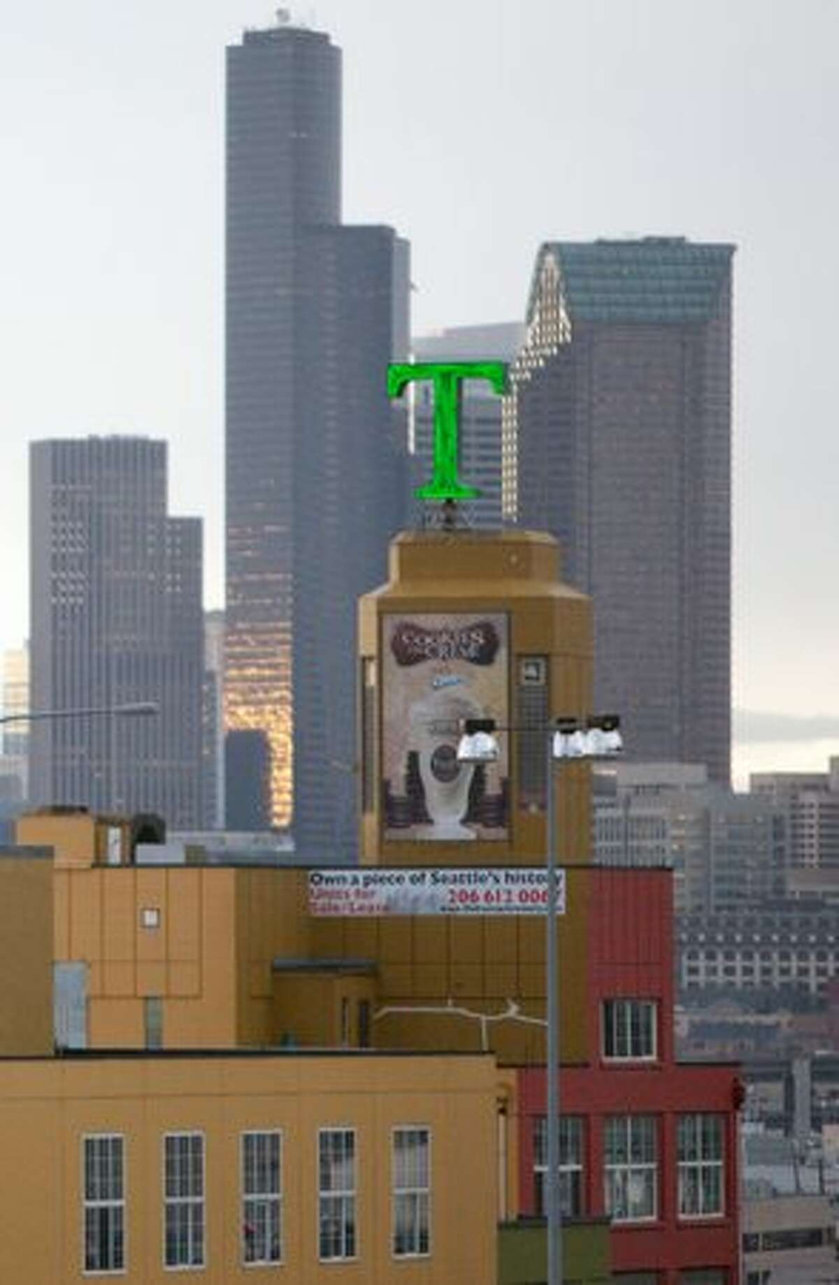 The Tully's buidling and former Rainier Brewery is shown with the downtown skyline in the background.