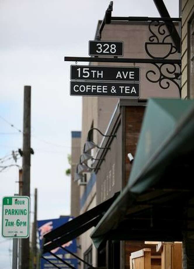 The sign of Starbucks' new 15th Avenue Coffee & Tea blends into the streetscape in Seattle's north Capitol Hill. The store is part of a project where Starbucks is trying to rebrand stores to blend into neighborhoods and be more of a community gathering place. The store opens for business on Friday, July 24. Photo: Joshua Trujillo, Seattlepi.com
