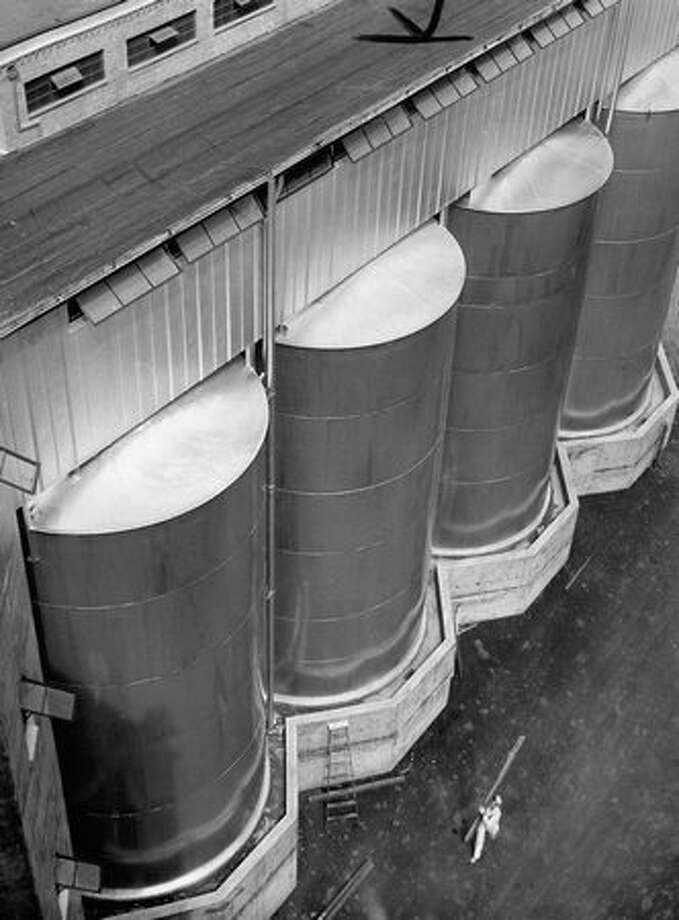 Grain storage tanks at Rainier Beer's Sicks' Seattle Brewing and Malting Company. August 1949 Photo: P-I File