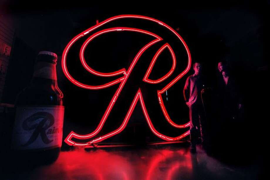 "Rainier neon ""R"" shown at MOHAI. Photo: Phil H. Webber, Seattle Post-Intelligencer"