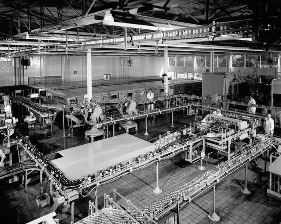Rainier Brewery's new $2,500,000 packaging center at Sick's Seattle Brewing and Malting Company is seen as a model for the whole brewing industry. August 1956. Photo: P-I File