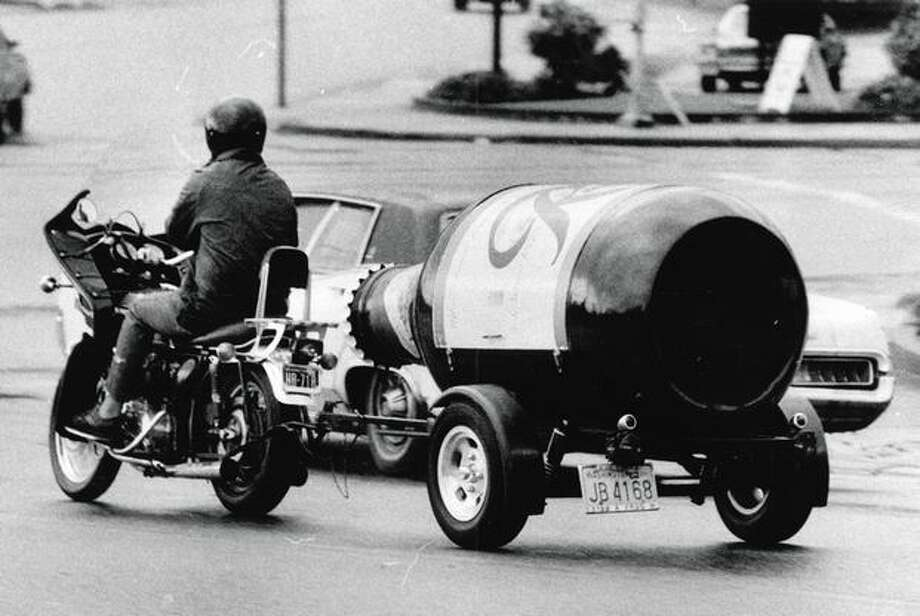 A giant Rainier beer bottle is pulled by motorcycle, May 14, 1978. Photo: P-I File