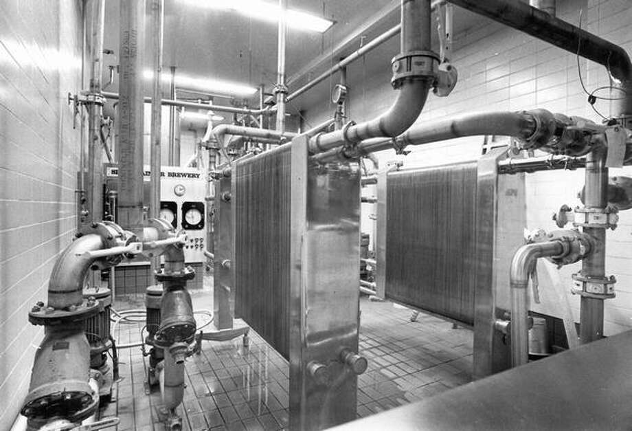 A hop mixture is pumped through the system at Rainier Brewery, Sept. 19, 1975. Photo: P-I File