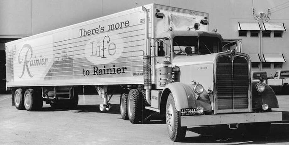 The August 1955 photo caption read: A Kenworth truck joined the fleet of the Sick's Seattle Brewing and Malting Co. and is ready to roll with 25,000 bottles of beer. Photo: P-I File