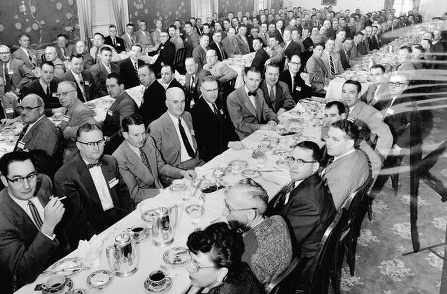 Rainier Brewery sales organization members and their wives are shown at a breakfast that opened their day-long meeting in Seatle, December 1954. Photo: P-I File