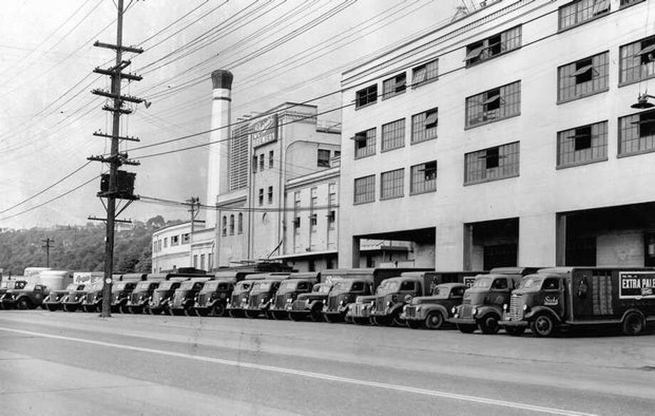 Sick's Seattle Brewing and Malting Co.'s fleet of trucks in front of the Rainier Brewery. August 1949 Photo: P-I File