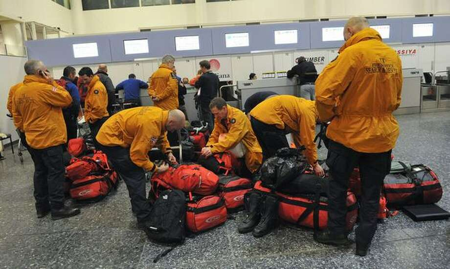British Search and Rescue teams prepare to leave Gatwick airport, West Sussex to provide assistance to relief and rescue teams in Haiti, on Jan. 13, 2010. Britain sent off a four-person emergency assessment team while assembling a 64-strong team of rescuers with sniffer dogs and equipment at London's Gatwick airport. Photo: Getty Images