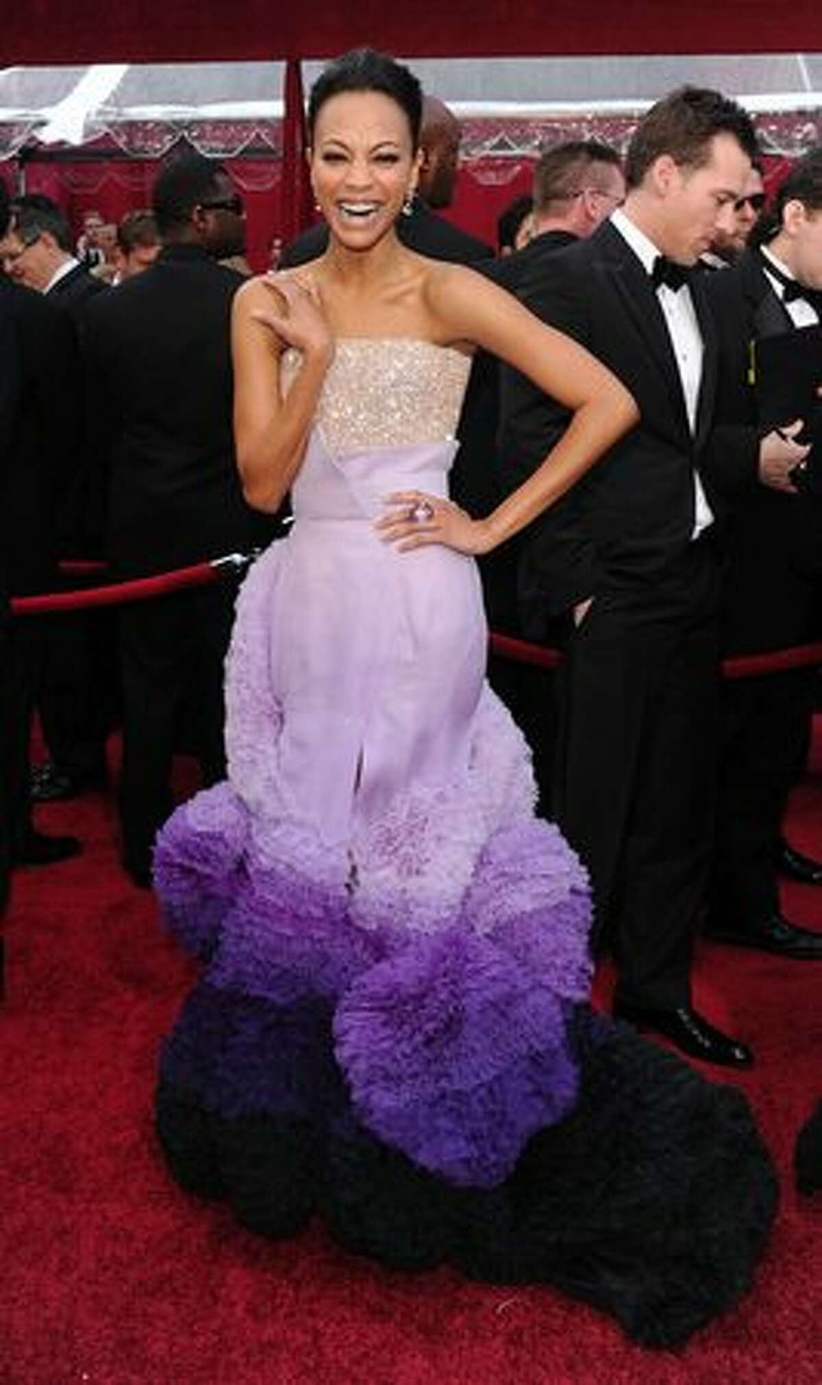 Right from the top let's just get this out in the open: What would possess so many beautiful women to put their hair up and hide it? That being said, let's get out the shears and deconstruct a few garments. Zoe Saldana's wearing a Givenchy couture gown which looks worse the longer you look at it.