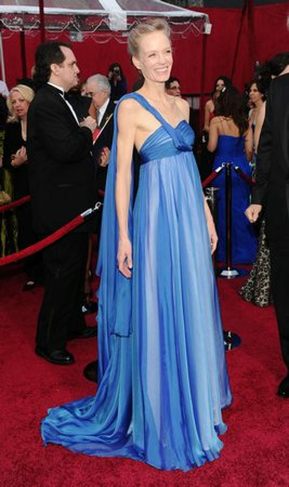 Suzy Amis used to be a pretty good actress before she got married to director James Cameron. Now she shows up with him at awards shows, wearing old-style gowns that don't fit her bony frame. And trust us, she has loads of gorgeous hair.
