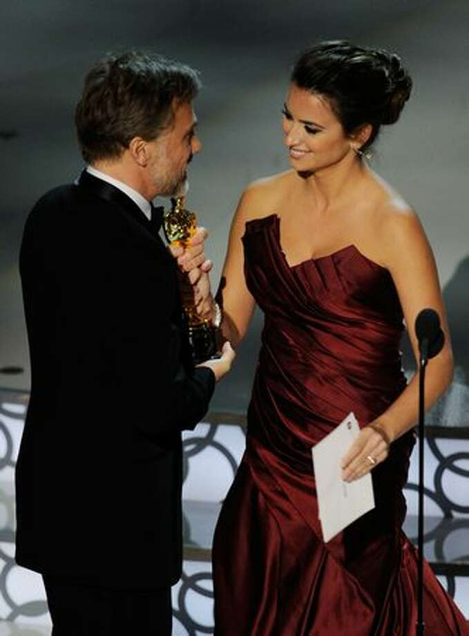 "Actor Christoph Waltz accepts Best Supporting Actor award for ""Inglourious Basterds"" from presenter actress Penelope Cruz onstage during the 82nd Annual Academy Awards held at Kodak Theatre in Hollywood, California. Photo: Getty Images"