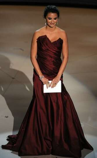 Actress and presenter Penelope Cruz announces the winner for Best Actor in a Supporting Role at the