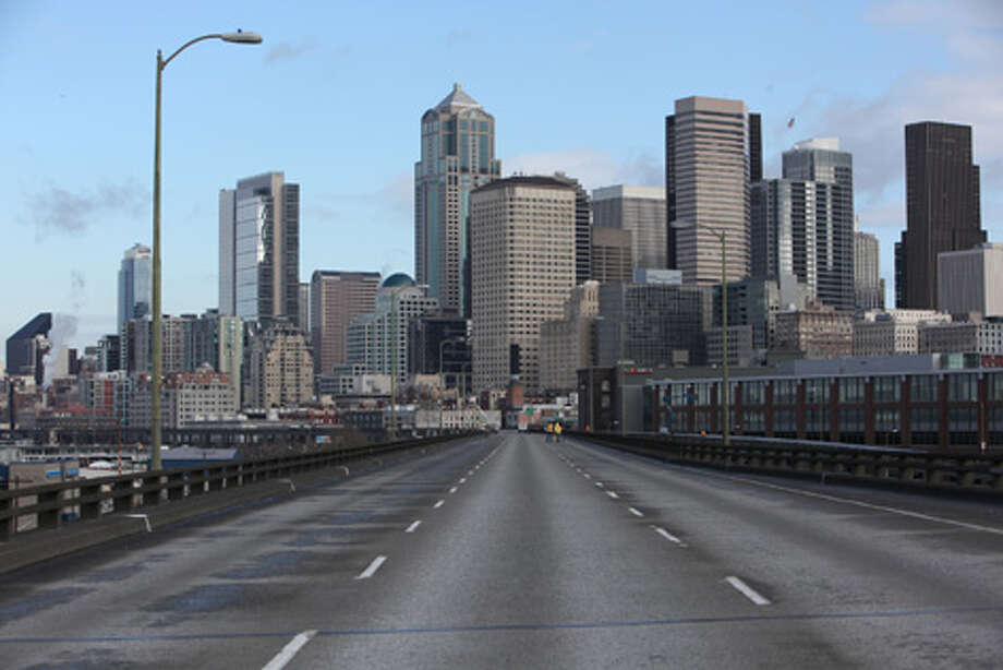 The Seattle skyline is shown beyond the upper deck of the Alaskan Way Viaduct on March 19. Photo: Joshua Trujillo/seattlepi.com