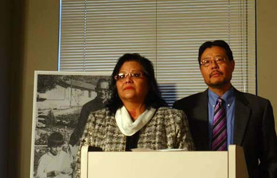 Clarita Vargas, a Colville Tribe member and Yakima resident abused at an Omak boarding school, and attorney Blaine Tamaki speak to reporters Friday after announcing an $166 million settlement with the Northwest division of the Catholic Jesuit order. Pending court approval, the settlement will be paid to about 470 people abused as children at boarding schools operated by the Society of Jesus, Oregon Province, including the Omak school where Vargas was victimized. Photo: Levi Pulkkinen/seattlepi.com