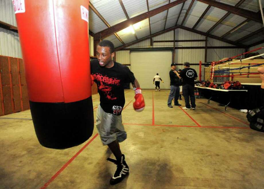 West Orange-Stark's basketball player, O'Shanique Williams-Foster works out at King's Gym in Orange, Thursday.  O'Shanique is the top seed of eight boxers in his weight class for the U.S. Olympic Trials. Tammy McKinley/The Enterprise Photo: TAMMY MCKINLEY / Beaumont
