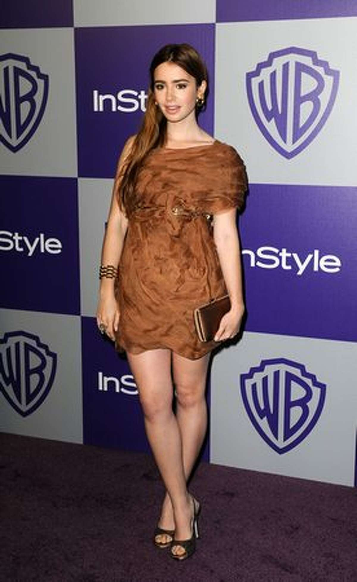 Actress Lily Collins arrives at the InStyle and Warner Bros. 67th Annual Golden Globes after party held at the Oasis Courtyard at The Beverly Hilton Hotel.