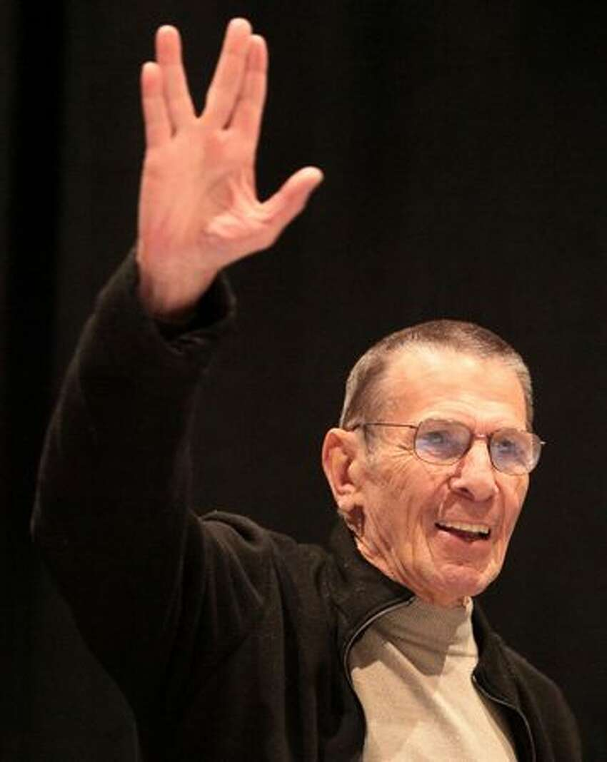 Actor Leonard Nimoy, best known as Mr. Spock from the Star Trek series, gives the iconic Vulcan salute during Emerald City ComiCon on Saturday March 13, 2010 at the Washington State Convention & Trade Center in Seattle.