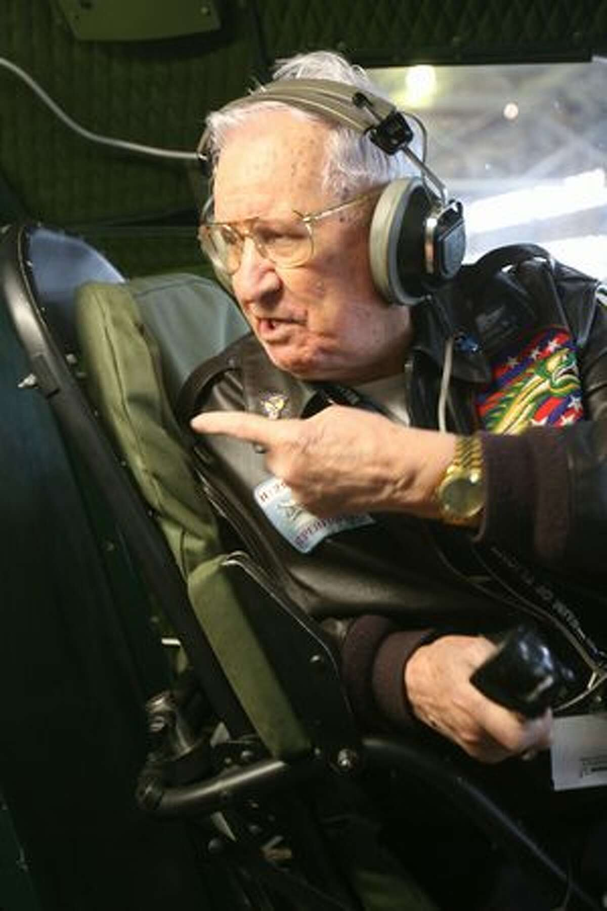 Retired U.S. Army Air Forces pilot Walter Sherrell sits in the familiar flight deck of a Boeing B-29 Superfortress bomber.