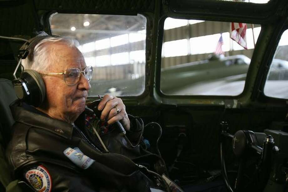 Retired U.S. Army Air Forces pilot Walter Sherrell sits in the familiar flight deck of a Boeing B-29 Superfortress bomber talking via radio with retired pilot Hank Hendrickson, who was in a Boeing B-17 Flying Fortress. Photo: Aubrey Cohen, Seattlepi.com