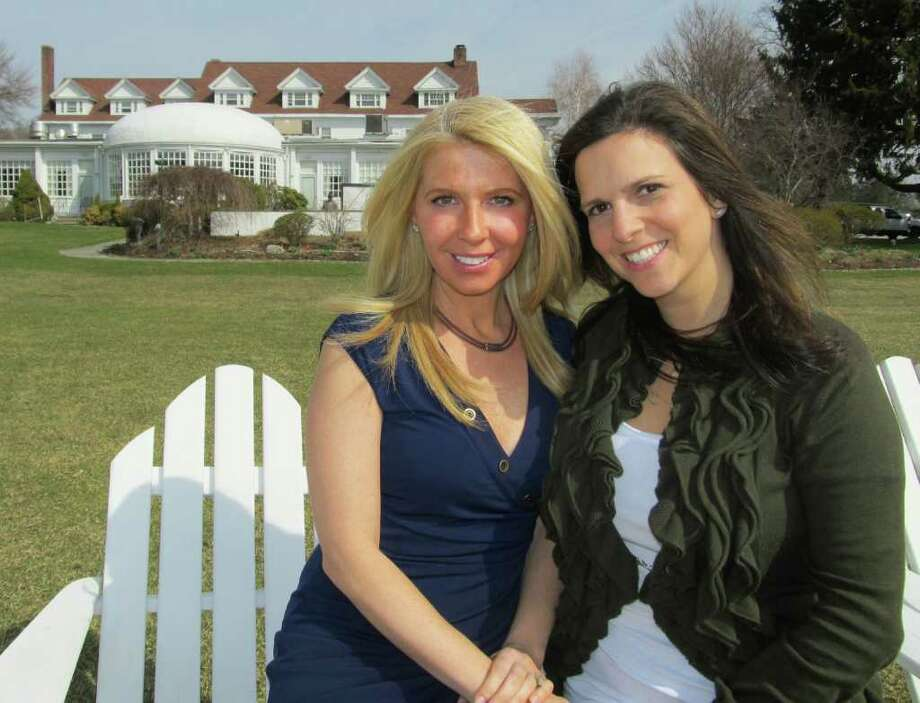 Couposh.com founders Jara Negrin, left, and Amy Nebens at the Inn at Longshore in Westport. One of their online coupons is for discounted lodging there and dinner. Photo: Contributed Photo / Westport News